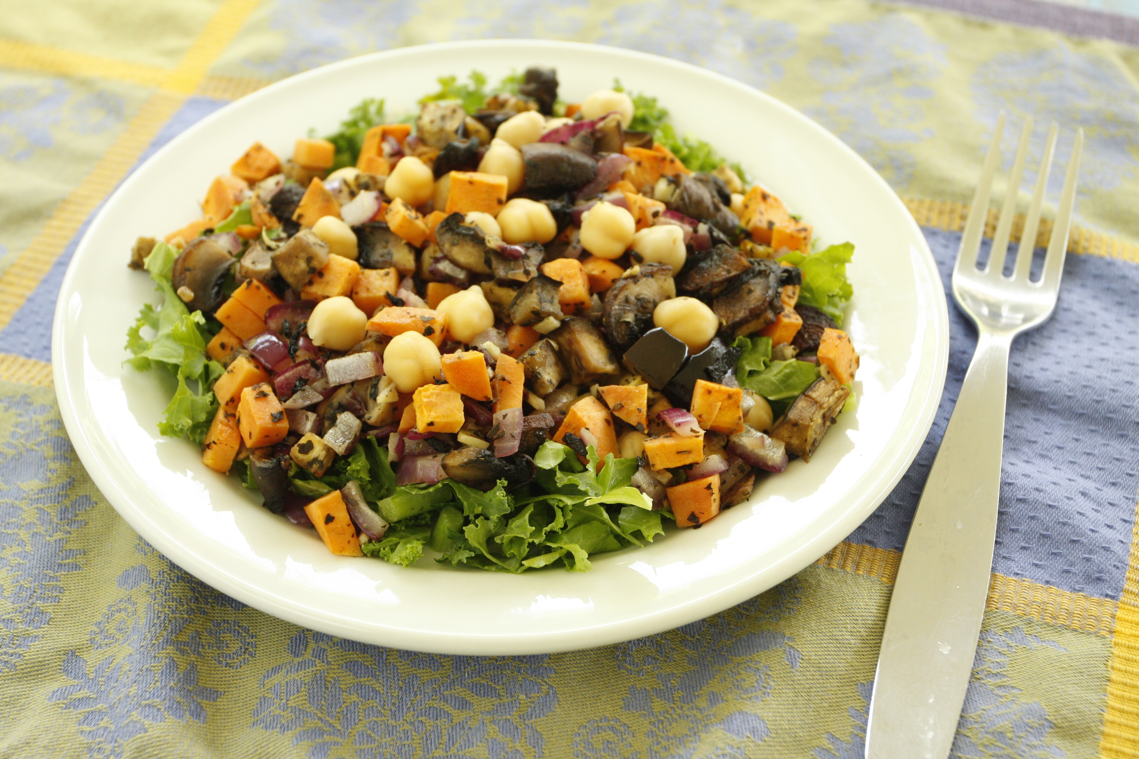 Baked vegetables with chickpeas on salad